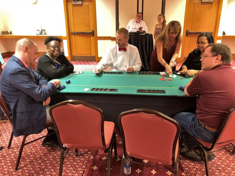 Accounting Research Conference attendees enjoying a charity poker tournament after a day of discussing leading reasearch in accounting.