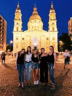 Maria Keener (2nd from right) and fellow Hokie Yurie Choe (second from left) with KPMG Global Advantage participants in front of St. Stephen's Basilica in Budapest, Hungary.