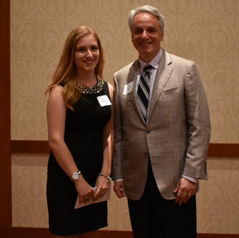 Chris Xystros, KPMG presents Marissa Vahlkamp, Master of Ceremonies for the evening with the KPMG Leadership Award