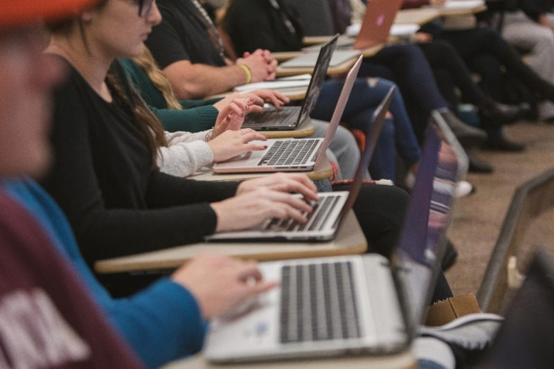 Row of students with laptops